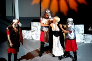 English Antigone (Eleni Rebecca) is arrested by the guards and Captain Jonas (Frank Cannizzo)